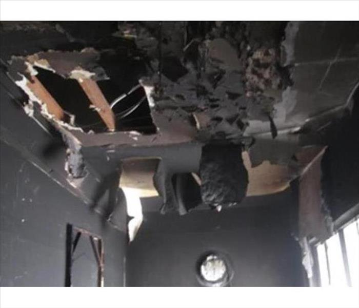 Blackened hanging ceiling material after the fire