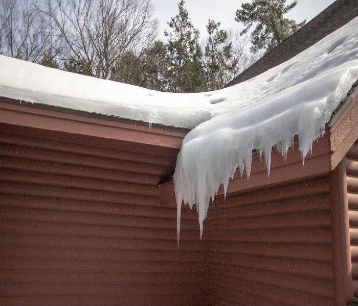 Icicles Hang From Ice Dam On Roof