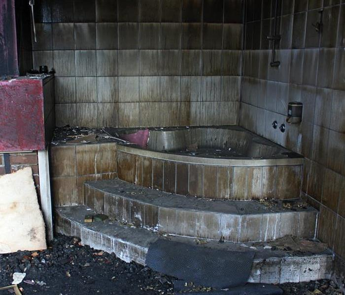 Bathroom with fire and soot damage.